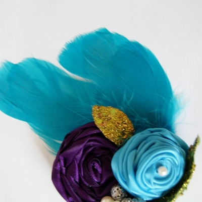 Blue and purple ribbon flowers with blue feathers