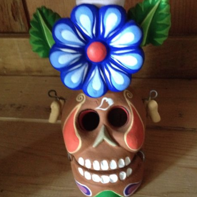 Mexican folk art day of the dead skull candle holder