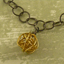 Gold & Black Wire Orbital Ball Pendant Necklace