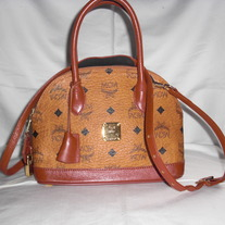MCM MINI MUNCHEN MONOGRAM CROSS BODY.