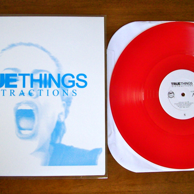 "True things ""distractions"" - ltd. 12"" /300 [translucent maroon] 2 copies left"