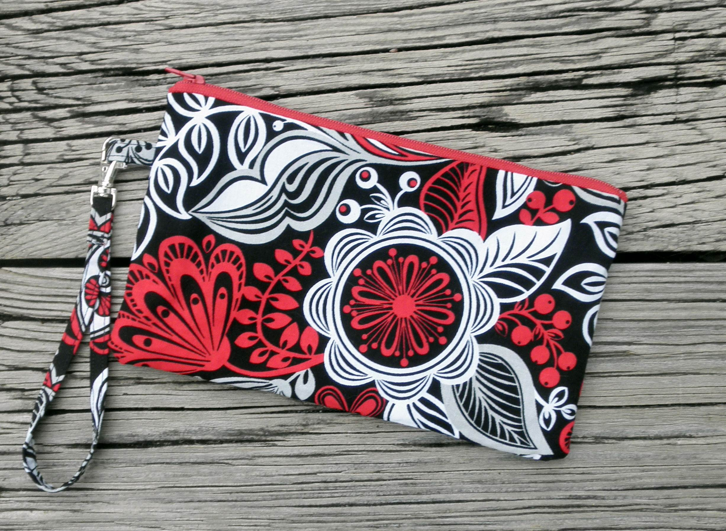 http://ladylack.storenvy.com/collections/380454-wristlets/products/3648160-red-black-and-grey-flower-wristlet
