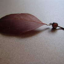 Real feather, peach belly navel ring.