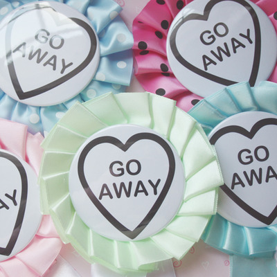 """go away"" rosette pin"