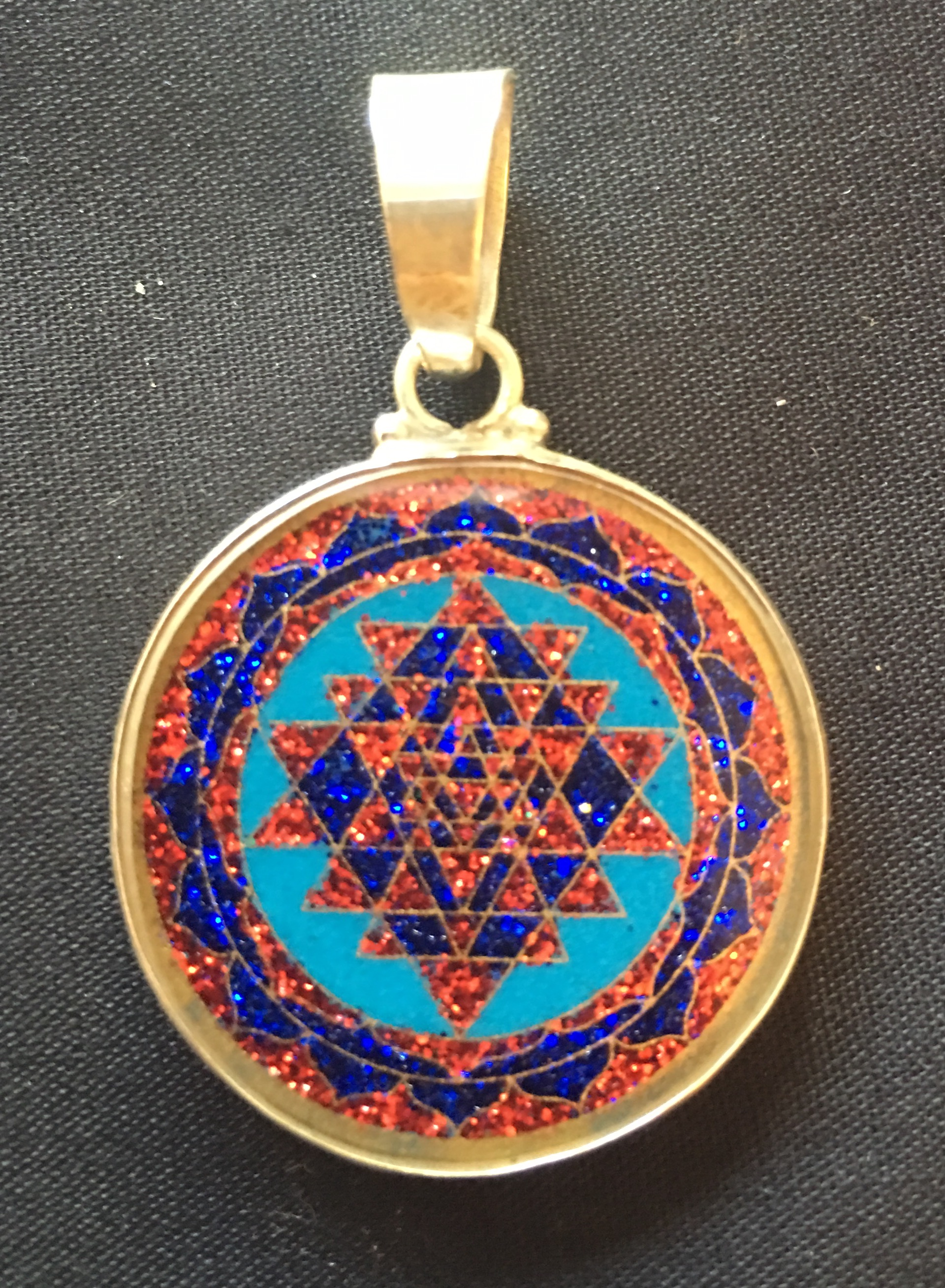 Sri Yantra sacred geometry pendant from Rainbows of Healing Boutique