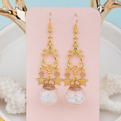 c4d20052fdecdb Gold tone star crystal floating potion ball long statement dangle earrings